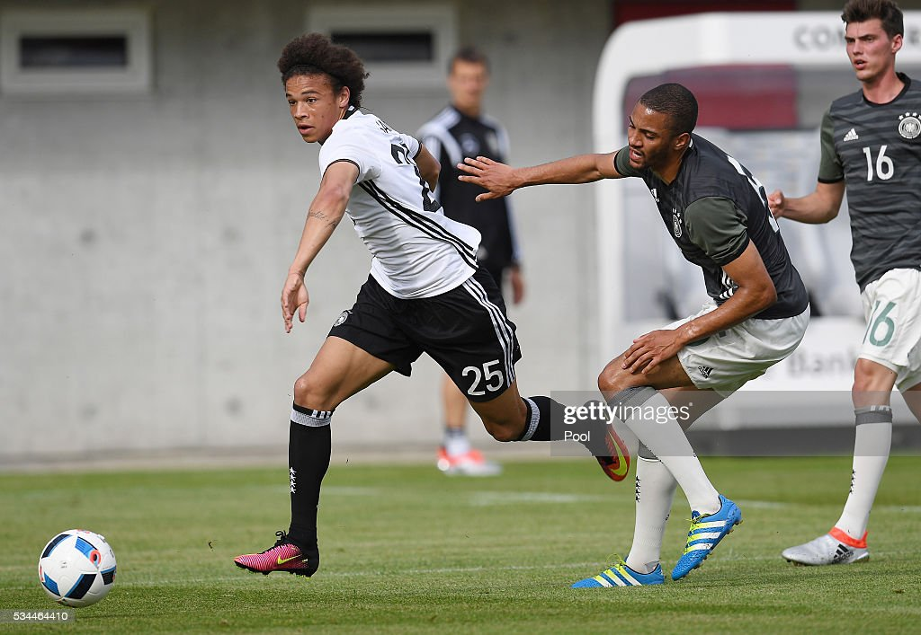Leroy Sane (L) of Germany vies with Malcolm Cacutalua of Germany U20 during a friendly match as part of their training camp on May 26, 2016 in Ascona, Switzerland.