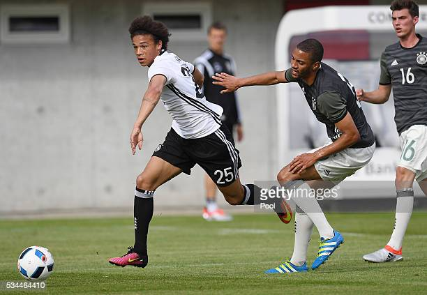 Leroy Sane of Germany vies with Malcolm Cacutalua of Germany U20 during a friendly match as part of their training camp on May 26 2016 in Ascona...