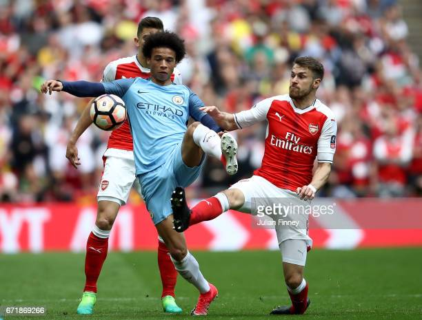 Leroy Sane of Manchester City and Aaron Ramsey of Arsenal compete for the ball during the Emirates FA Cup SemiFinal match between Arsenal and...
