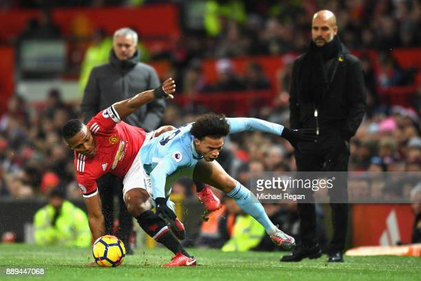Leroy Sane of Manchester City and Antonio Valencia of Manchester United clash as Josep Guardiola Manager of Manchenster City and Jose Mourinho...