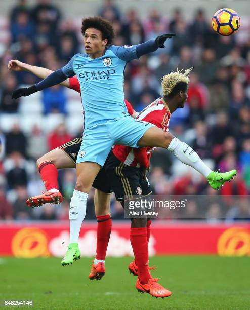 Leroy Sane of Manchester City and Dider N'dong of Sunderland battle to win a header during the Premier League match between Sunderland and Manchester...