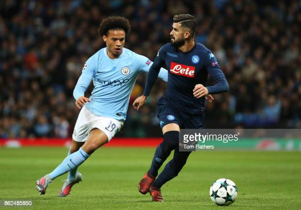 Leroy Sane of Manchester City and Elseid Hysaj of SSC Napoli battle for possession during the UEFA Champions League group F match between Manchester...