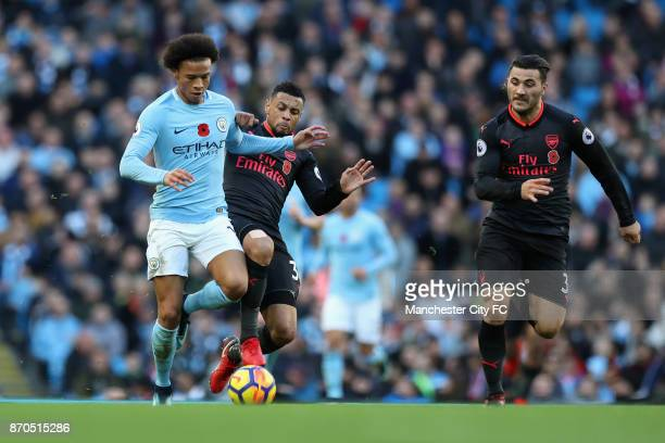 Leroy Sane of Manchester City and Francis Coquelin of Arsneal battle for possession during the Premier League match between Manchester City and...