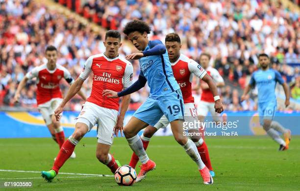 Leroy Sane of Manchester City and Gabriel of Arsenal compete for the ball during the Emirates FA Cup SemiFinal match between Arsenal and Manchester...