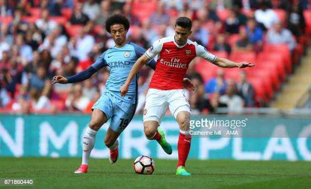 Leroy Sane of Manchester City and Gabriel Paulista of Arsenal during the Emirates FA Cup semifinal match between Arsenal and Manchester City at...