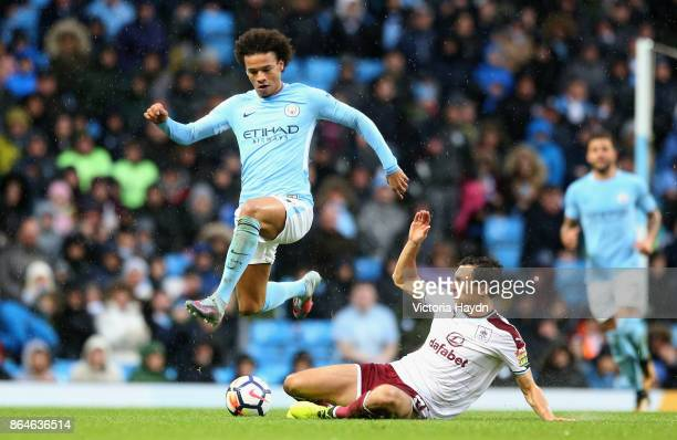 Leroy Sane of Manchester City and Jack Cork of Burnley battle for the ball during the Premier League match between Manchester City and Burnley at...