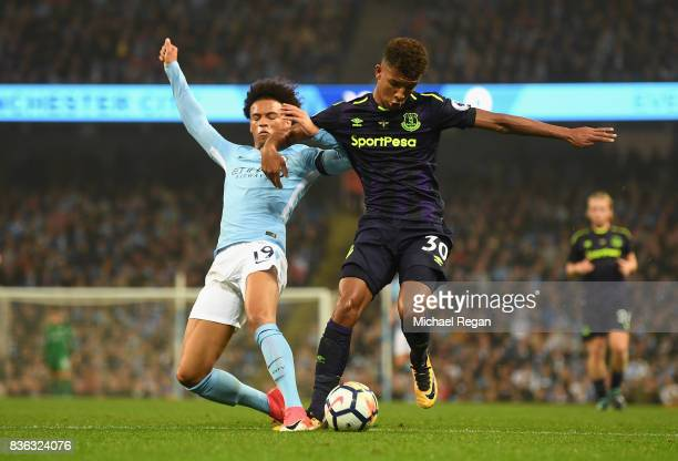 Leroy Sane of Manchester City and Mason Holgate of Everton battle for possession during the Premier League match between Manchester City and Everton...
