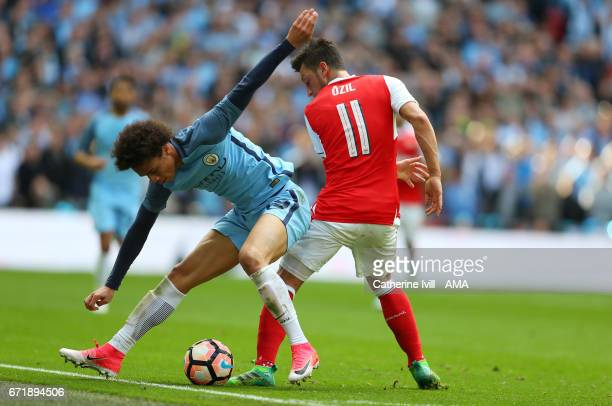 Leroy Sane of Manchester City and Mesut Ozil of Arsenal during the Emirates FA Cup semifinal match between Arsenal and Manchester City at Wembley...