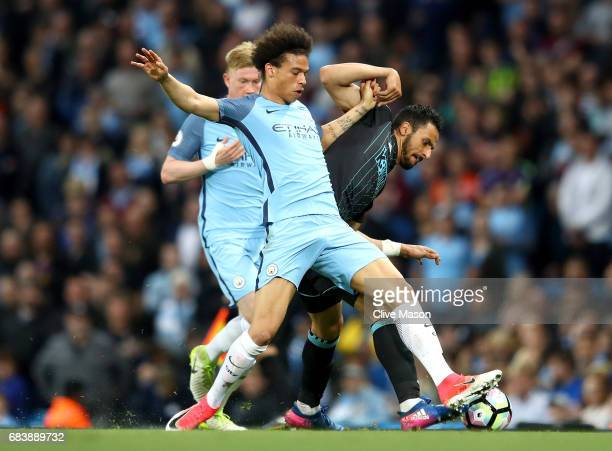 Leroy Sane of Manchester City and Nacer Chadli of West Bromwich Albion battle for possession during the Premier League match between Manchester City...