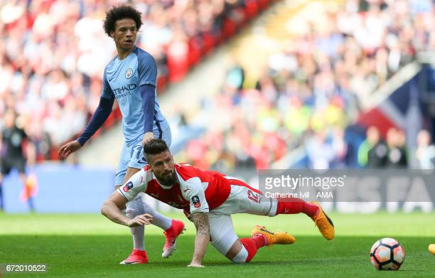 Leroy Sane of Manchester City and Olivier Giroud of Arsenal during the Emirates FA Cup semifinal match between Arsenal and Manchester City at Wembley...