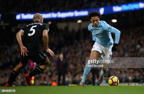 Leroy Sane of Manchester City and Pablo Zabaleta of West Ham United in action during the Premier League match between Manchester City and West Ham...