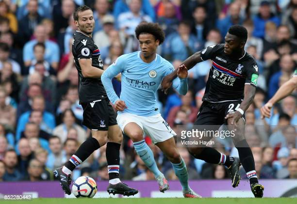 Leroy Sane of Manchester City and Timothy FosuMensah of Crystal Paalce battle for possession during the Premier League match between Manchester City...