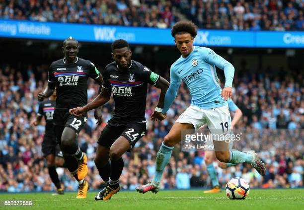 Leroy Sane of Manchester City and Timothy FosuMensah of Crystal Paalce compete for the ball during the Premier League match between Manchester City...