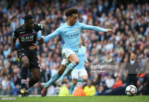 Leroy Sane of Manchester City and Timothy FosuMensah of Crystal Palace compete for the ball during the Premier League match between Manchester City...