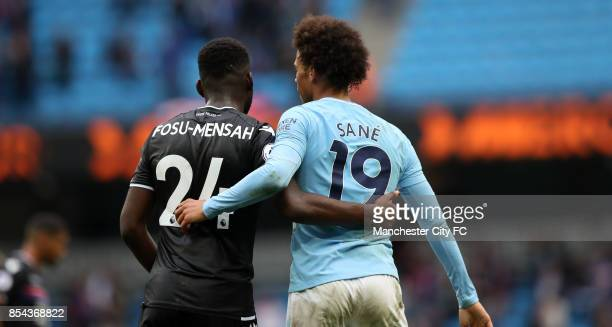 Leroy Sane of Manchester City and Timothy FosuMensah of Crystal Palace during the Premier League match between Manchester City and Crystal Palace at...