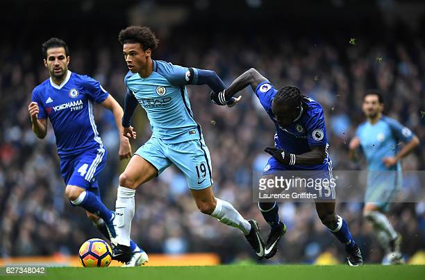 Leroy Sane of Manchester City and Victor Moses of Chelsea compete for the ball during the Premier League match between Manchester City and Chelsea at...