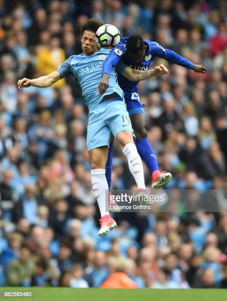Leroy Sane of Manchester City and Wilfred Ndidi of Leicester City battle to win a header during the Premier League match between Manchester City and...