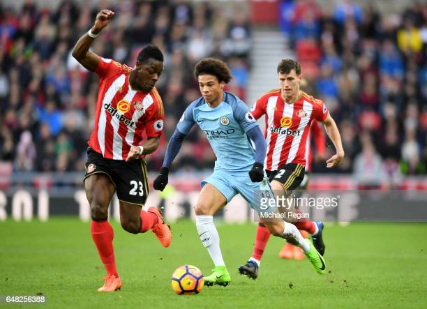 Leroy Sane of Manchester City attempts to take the ball past Lamine Kone of Sunderland during the Premier League match between Sunderland and...