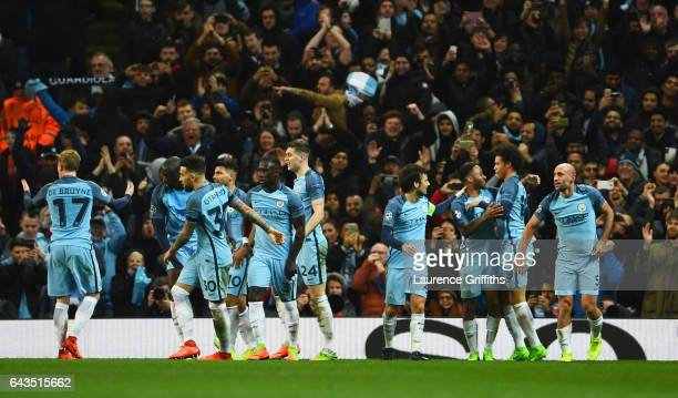 Leroy Sane of Manchester City celebrates as he scores their fifth goal with team mates during the UEFA Champions League Round of 16 first leg match...