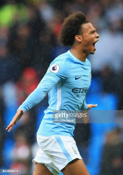 Leroy Sane of Manchester City celebrates scoring his sides fifth goal during the Premier League match between Manchester City and Liverpool at Etihad...