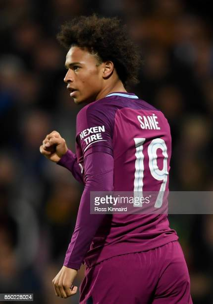 Leroy Sane of Manchester City celebrates scoring his sides first goal during the Carabao Cup Third Round match between West Bromwich Albion and...