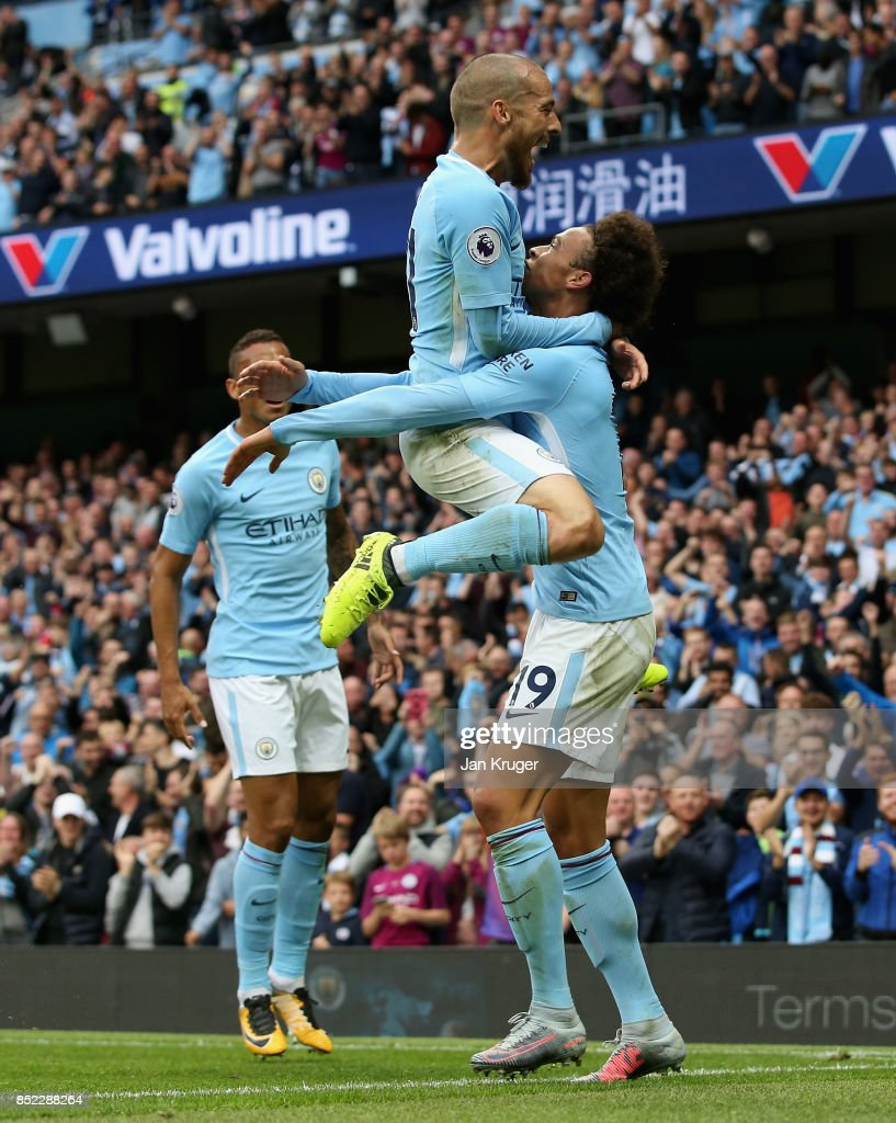 Leroy Sane (R) of Manchester City celebrates scoring his sides first goal with his team mate David Silva (C) during the Premier League match between Manchester City and Crystal Palace at Etihad Stadium on September 23, 2017 in Manchester, England.