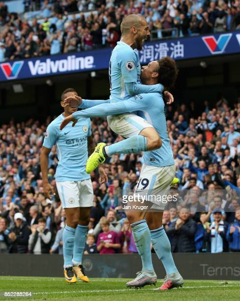 Leroy Sane of Manchester City celebrates scoring his sides first goal with his team mate David Silva during the Premier League match between...