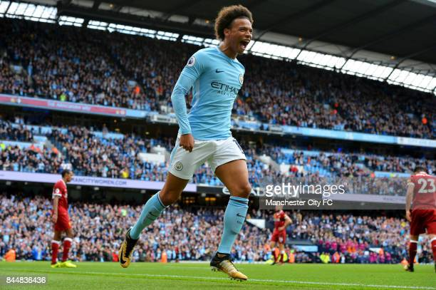 Leroy Sane of Manchester City celebrates scoring his sides fourth goal during the Premier League match between Manchester City and Liverpool at...