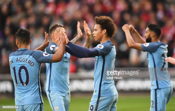 Leroy Sane of Manchester City celebrates scoring his sides second goal with Sergio Aguero of Manchester City during the Premier League match between...