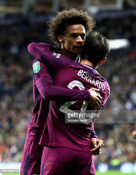 Leroy Sane of Manchester City celebrates scoring his sides second goal with Bernardo Silva of Manchester City during the Carabao Cup Third Round...