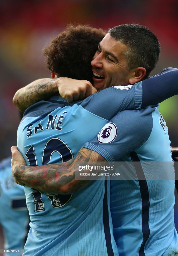 Leroy Sane of Manchester City celebrates scoring the second goal to make the score 0-2 with Aleksandar Kolarov during the Premier League match between Sunderland and Manchester City at Stadium of Light on March 5, 2017 in Sunderland, England.