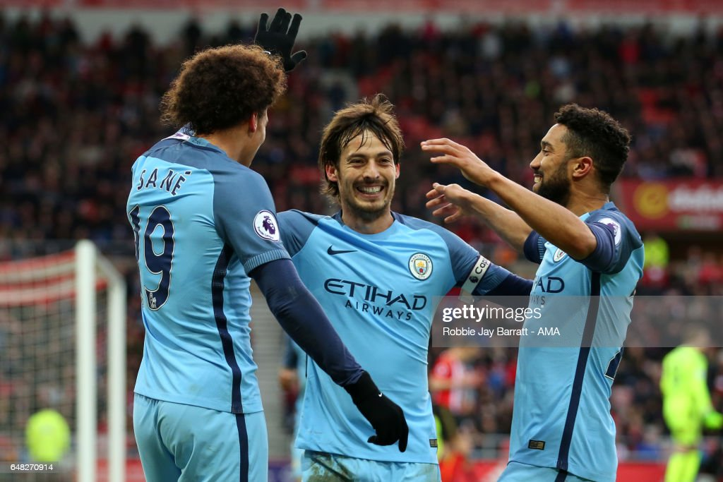 Leroy Sane of Manchester City celebrates scoring the second goal to make the score 0-2 with team-mates David Silva and Gael Clichy (R) during the Premier League match between Sunderland and Manchester City at Stadium of Light on March 5, 2017 in Sunderland, England.