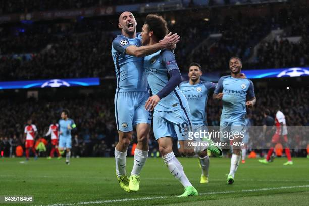 Leroy Sane of Manchester City celebrates with his teammate Pablo Zabaleta after scoring his team's fifth goal to make the score 53 during the UEFA...