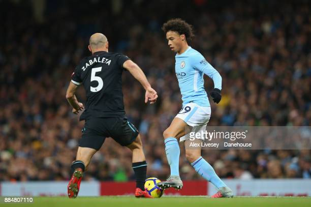Leroy Sane of Manchester City challenges Pablo Zabaleta of West Ham United during the Premier League match between Manchester City and West Ham...