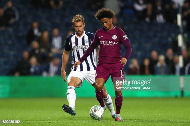 Leroy Sane of Manchester City competes with Craig Dawson of West Bromwich Albion during the Carabao Cup third round match between West Bromwich...