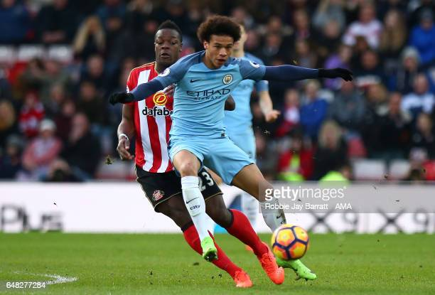 Leroy Sane of Manchester City competes with Lamine Kone of Sunderland during the Premier League match between Sunderland and Manchester City at...