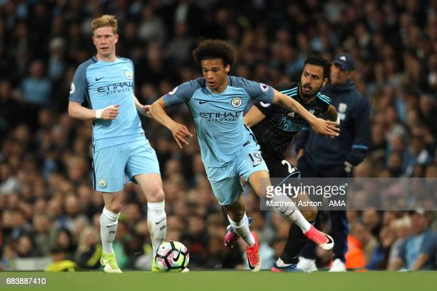 Leroy Sane of Manchester City competes with Nacer Chadli of West Bromwich Albion during the Premier League match between Manchester City and West...