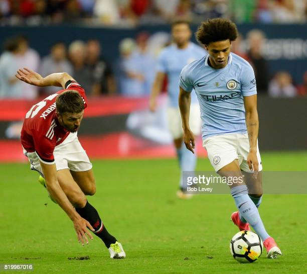 Leroy Sane of Manchester City dribbles around Michael Carrick of Manchester United in the second half at NRG Stadium on July 20 2017 in Houston Texas