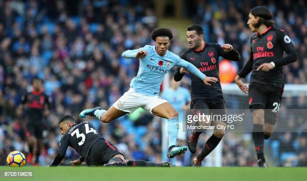 Leroy Sane of Manchester City esacpes a challenge from Francis Coquelin of Arsneal during the Premier League match between Manchester City and...
