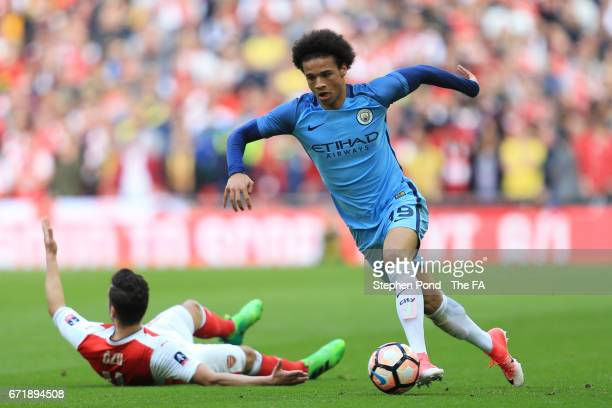 Leroy Sane of Manchester City evades Mesut Ozil of Arsenal during the Emirates FA Cup SemiFinal match between Arsenal and Manchester City at Wembley...