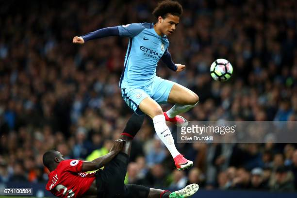 Leroy Sane of Manchester City is tackled by Eric Bailly of Manchester United during the Premier League match between Manchester City and Manchester...