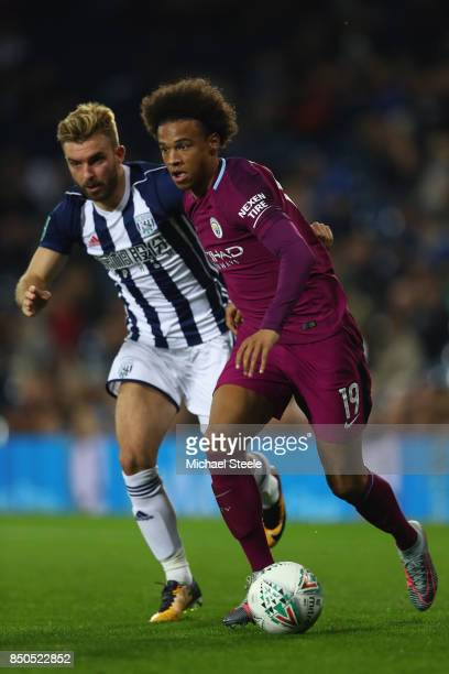 Leroy Sane of Manchester City is tracked by James Morrison of West Bromwich Albion during the Carabao Cup Third Round match between West Bromwich...