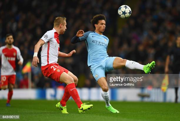 Leroy Sane of Manchester City is watched by Benjamin Mendy of AS Monaco during the UEFA Champions League Round of 16 first leg match between...