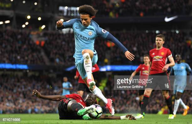 Leroy Sane of Manchester City rides a tackle from Eric Bailly of Manchester United during the Premier League match between Manchester City and...