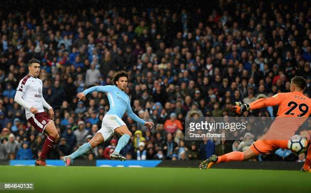 Leroy Sane of Manchester City scores his side's 3rd goal during the Premier League match between Manchester City and Burnley at Etihad Stadium on...