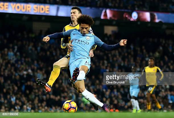 Leroy Sane of Manchester City scores his sides first goal during the Premier League match between Manchester City and Arsenal at the Etihad Stadium...