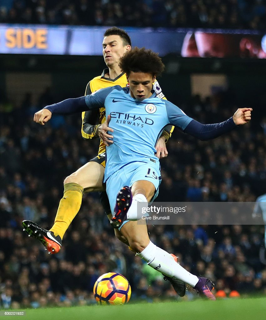 Leroy Sane of Manchester City (C) scores his sides first goal during the Premier League match between Manchester City and Arsenal at the Etihad Stadium on December 18, 2016 in Manchester, England.