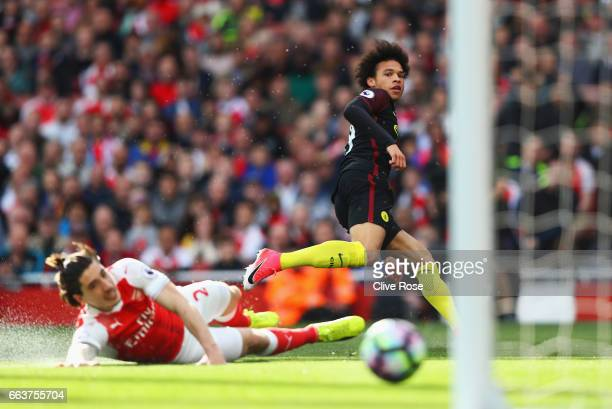Leroy Sane of Manchester City scores his sides first goal during the Premier League match between Arsenal and Manchester City at Emirates Stadium on...