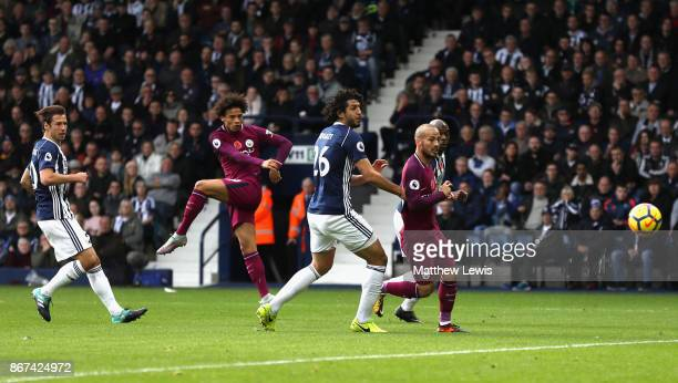 Leroy Sane of Manchester City scores his sides first goal during the Premier League match between West Bromwich Albion and Manchester City at The...