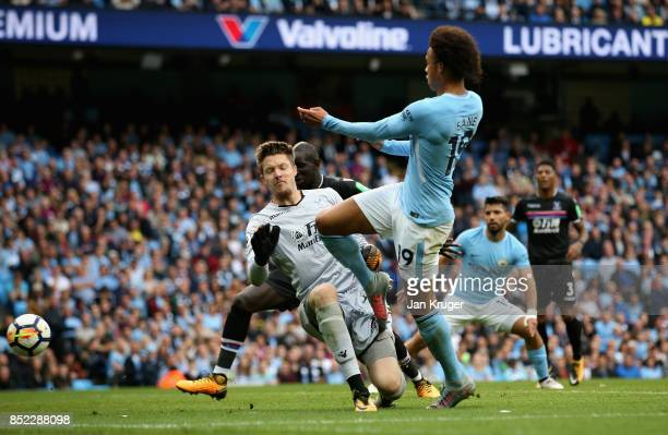 Leroy Sane of Manchester City scores his sides first goal past Wayne Hennessey of Crystal Palace during the Premier League match between Manchester...